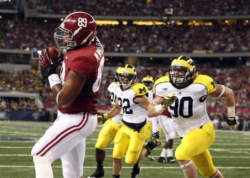 Alabama tight end Michael Williams (89) pulls in a touchdown pass in front of Michigan linebacker Jake Ryan (90) and safety Jordan Kovacs (32) during the first half of an NCAA college football game at Cowboys Stadium in Arlington, Texas, Saturday, Sept. 1, 2012. (AP Photo/LM Otero)