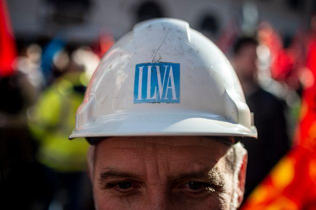 ROME, ITALY - DECEMBER 10: People take part in a national demonstration on corporate crisis, on December 10, 2019 in Rome, Italy. Today trade unions representing steel workers staged a national demonstration. The government continues talks to stop ArcelorMittal going back on an agreement to take over the former ILVA group. (Photo by Antonio Masiello/Getty Images)