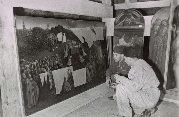 PHOTO: Monuments Men Lt. Daniel J. Kern and German conservator Karl Sieber examine Jan van Eyck's Adoration of the Mystic Lamb, also known as the Ghent Altarpiece, 1945. (Archives of American Art, Smithsonian Institution)