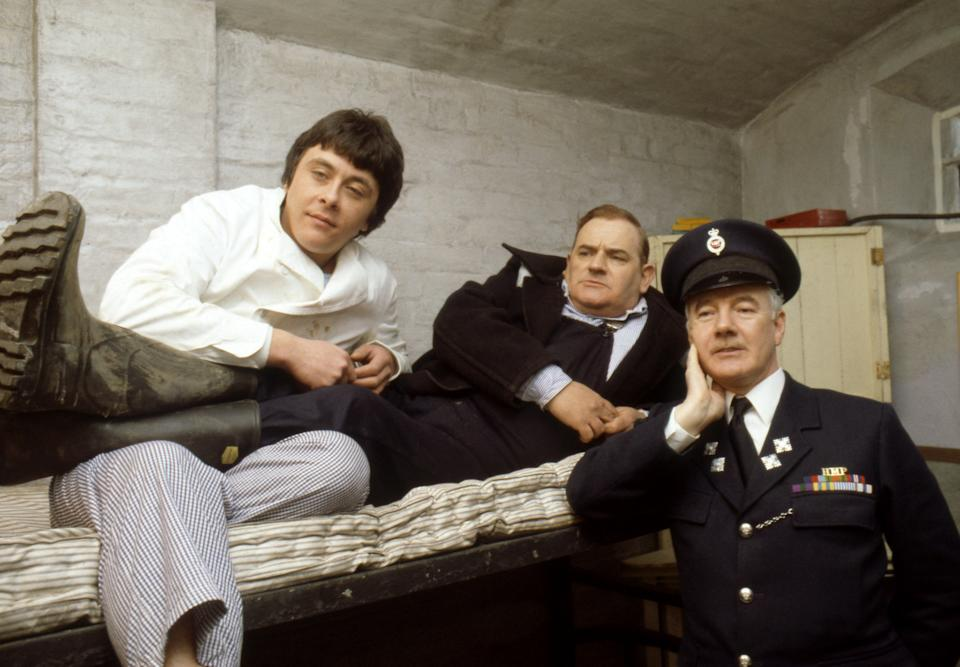 Old lag Fletcher (Ronnie Barker), fellow prisoner Godber (Richard Beckinsale) and prison officer Mackay (Fulton Mackay) during location shooting for the film version of their TV series
