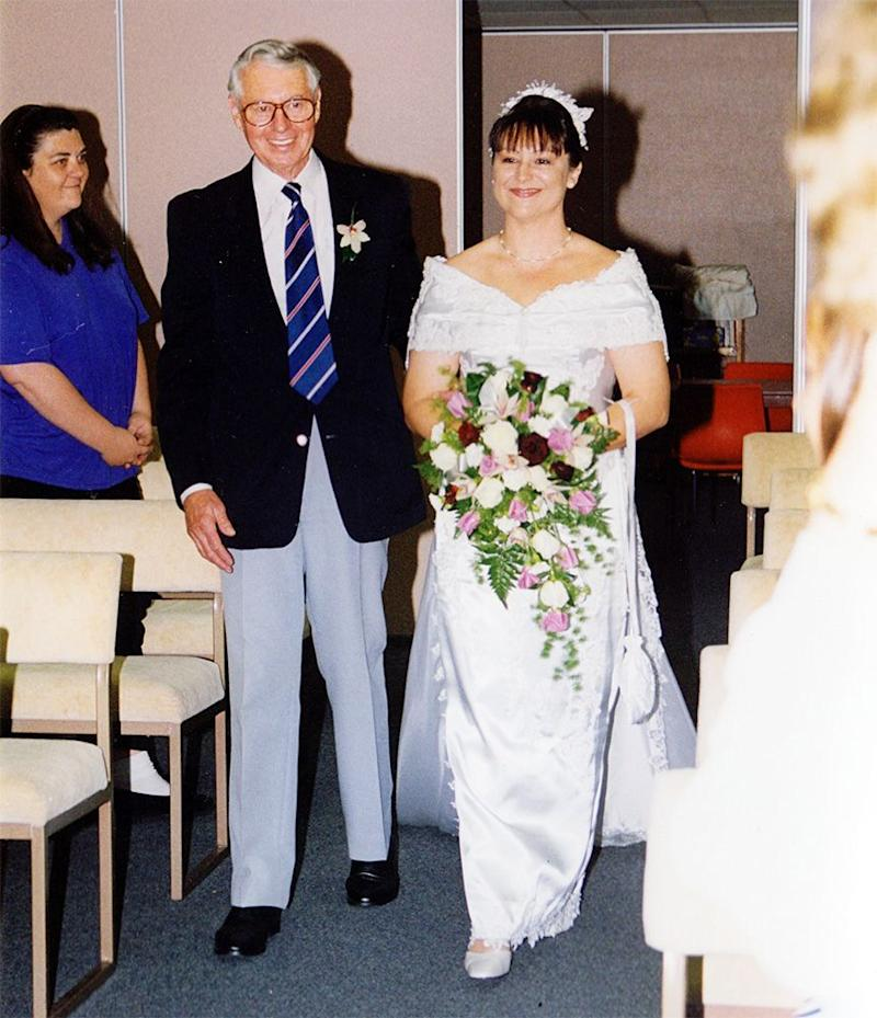 Robert walked Tonya down the aisle on her wedding day.