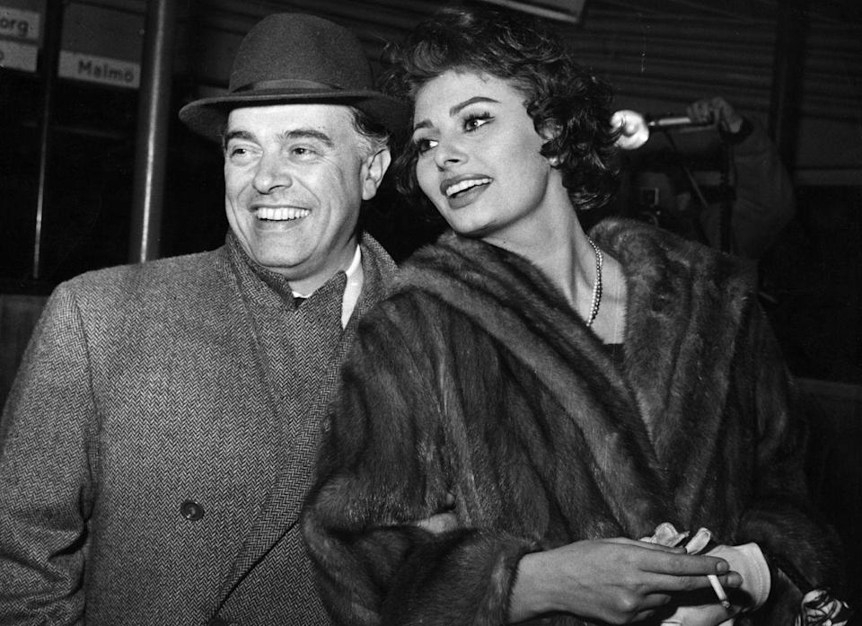 """<p>Sophia Loren and Carlo Ponti's road to marriage was rocky, as the Italian film producer was married with two children when they met. In 1957, they <a href=""""https://www.vanityfair.com/hollywood/2012/03/sophia-loren-201203"""" rel=""""nofollow noopener"""" target=""""_blank"""" data-ylk=""""slk:wed by proxy in Mexico"""" class=""""link rapid-noclick-resp"""">wed by proxy in Mexico</a>. For years after, they were forced to live in exile, as charges of bigamy were raised against them in Italy and by the Vatican. In 1962, it was revealed that their marriage was not valid, so it was annulled, and the couple remarried four years later in France. </p>"""