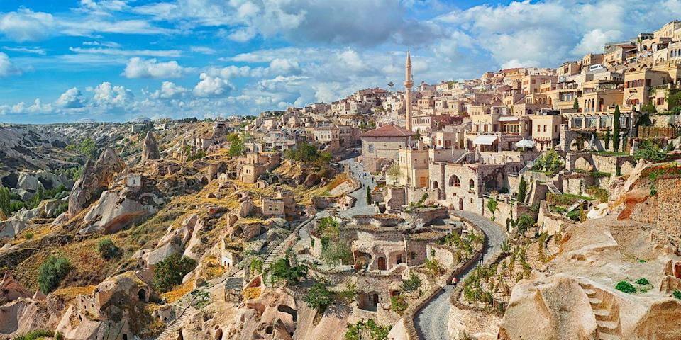 """<p><a href=""""https://www.tripadvisor.com/Tourism-g297980-Cappadocia-Vacations.html"""" rel=""""nofollow noopener"""" target=""""_blank"""" data-ylk=""""slk:Cappadocia"""" class=""""link rapid-noclick-resp"""">Cappadocia</a>, in central Turkey, is famous for its otherworldly volcanic rock formations, including pinnacles known as """"fairy chimneys."""" One of the best ways to see this lunar-looking landscape is from the air, especially via a sunrise balloon ride. In fact, Cappadocia is one of the hot air ballooning capitals of the world, so don't miss the chance to take one during your visit. </p>"""
