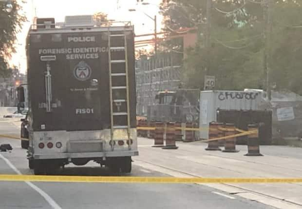 Police closed a stretch of Gerrard Street East for the investigation. (Linda Ward/CBC - image credit)
