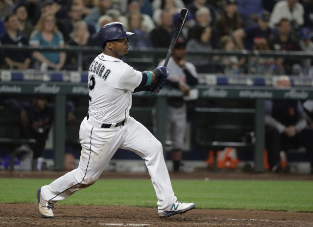 Seattle Mariners' Jean Segura watches his sacrifice fly against the Detroit Tigers during the sixth inning of a baseball game Saturday, May 19, 2018, in Seattle. Guillermo Heredia scored on the play. (AP Photo/Ted S. Warren)