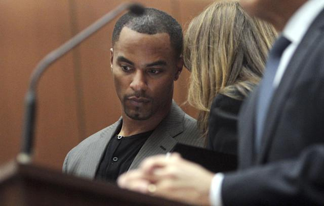 Former NFL safety Darren Sharper confers with his attorney Blair Berk during an appearance in Los Angeles Superior Court in Los Angeles, where he pleaded not guilty Thursday, Feb. 20, 2014, to charges of drugging and raping two women. Sharper's bail has been increased from $200,000 to $1 million. (AP Photo/Los Angeles Times, Bob Chamberlin, Pool)