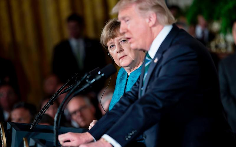 merkel Trump - Credit: AFP