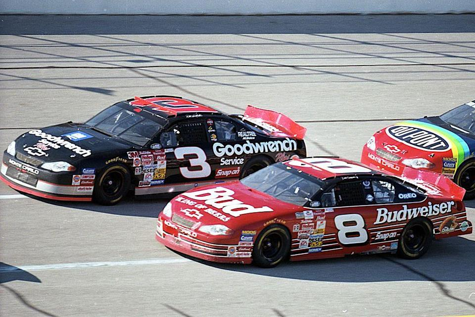 Dale Earnhardt Sr. and Jr. race at Talladega in 2000. (Getty)