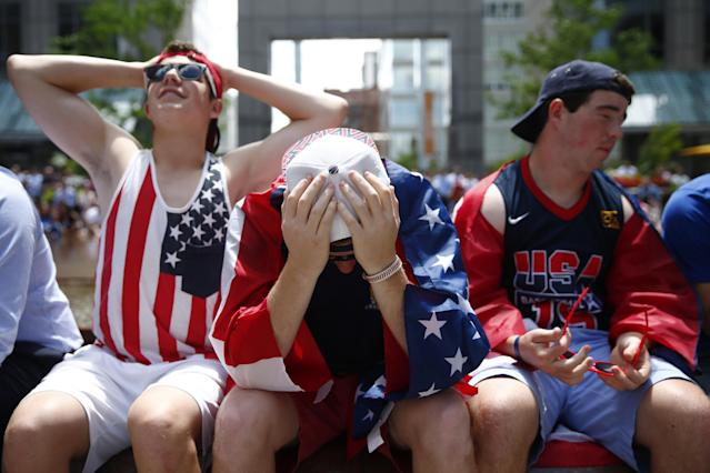 United States fans react while watching the 2014 World Cup soccer match between the United States and Germany at a public viewing party, Thursday, June 26, 2014, in Philadelphia. Germany defeated the United States 1-0 to win Group G ahead of the Americans, who also advanced to the knockout stage of the World Cup despite losing. (AP Photo/Matt Rourke)