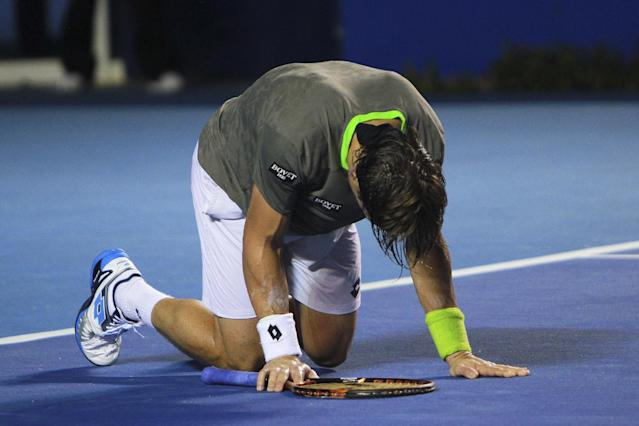 Spain's David Ferrer falls after failing a return while playing South Africa's Kevin Anderson at the Mexican Tennis Open in Acapulco, Mexico, Thursday Feb. 27, 2014. Ferrer retired from the match and Anderson won. (AP Photo/Hugo Avila-JAM MEDIA)