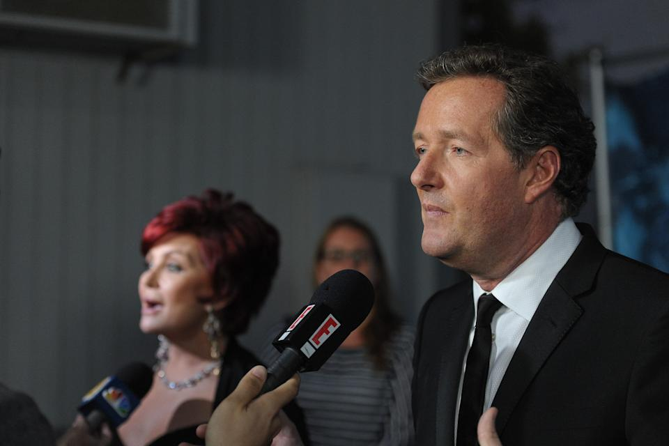 "LOS ANGELES, CA - SEPTEMBER 14:  Piers Morgan (R) and Sharon Osbourne attend NBC's ""America's Got Talent"" season finale at CBS Studios on September 14, 2011 in Los Angeles, California.  (Photo by Noel Vasquez/Getty Images)"