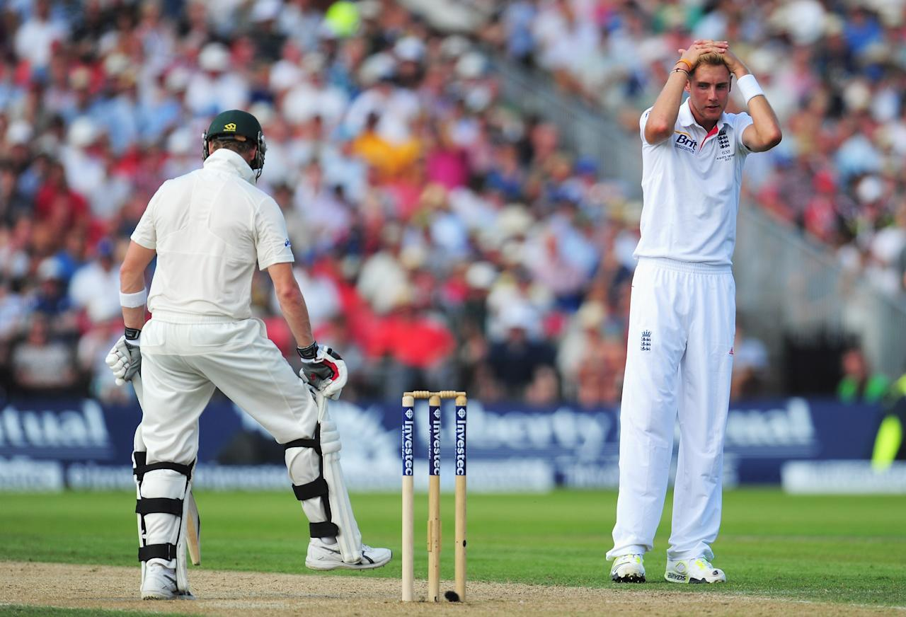MANCHESTER, ENGLAND - AUGUST 01: Stuart Broad of England holds his head after an appeal against Steve Smith of Australia was turned down during day one of the 3rd Investec Ashes Test match between England and Australia at Old Trafford Cricket Ground on August 1, 2013 in Manchester, England.  (Photo by Stu Forster/Getty Images)