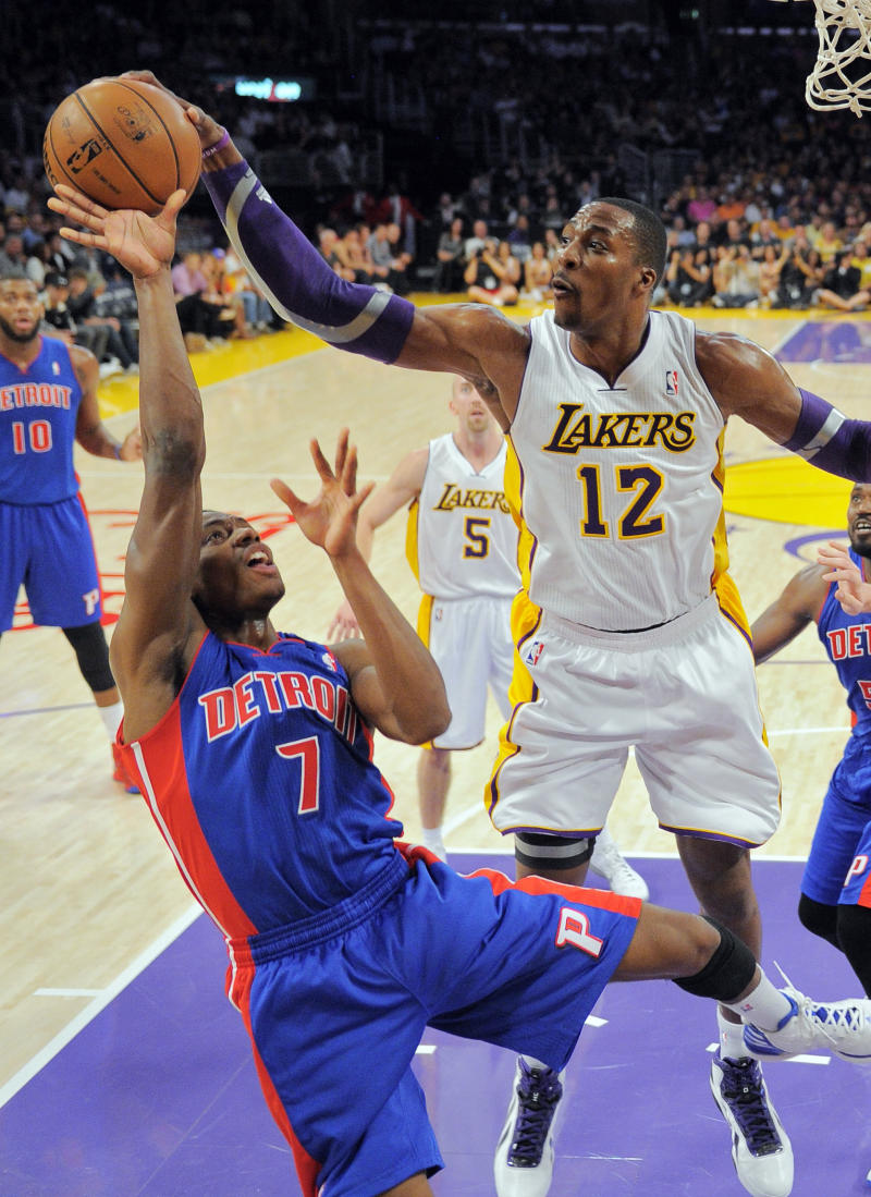 Los Angeles Lakers center Dwight Howard, right, blocks the shot of Detroit Pistons guard Brandon Knight during the first half of their NBA basketball game, Sunday, Nov. 4, 2012, in Los Angeles.  (AP Photo/Mark J. Terrill)