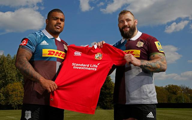 <span>Kyle Sinckler and Joe Marler pose with a British and Irish Lions jersey</span> <span>Credit: Getty Images </span>