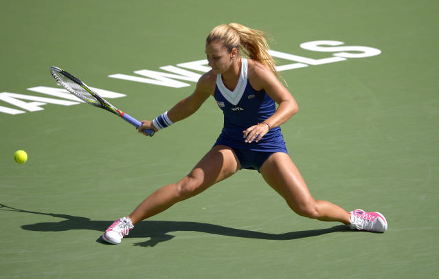 Dominika Cibulkova, of Slovakia, reaches for a hit from Li Na, of China, during a quarterfinal match at the BNP Paribas Open tennis tournament, Thursday, March 13, 2014 in Indian Wells, Calif. (AP Photo/Mark J. Terrill)