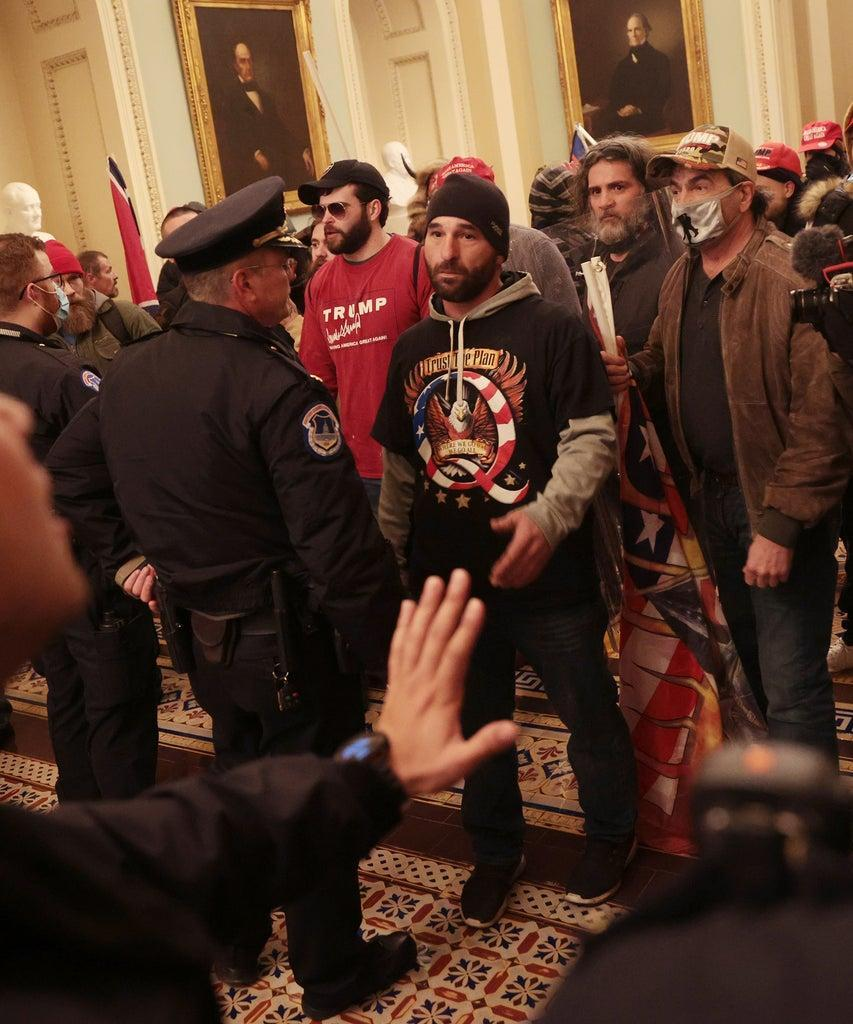 WASHINGTON, DC – JANUARY 06: Protesters interact with Capitol Police inside the U.S. Capitol Building on January 06, 2021 in Washington, DC. Congress held a joint session today to ratify President-elect Joe Biden's 306-232 Electoral College win over President Donald Trump. A group of Republican senators said they would reject the Electoral College votes of several states unless Congress appointed a commission to audit the election results. (Photo by Win McNamee/Getty Images)