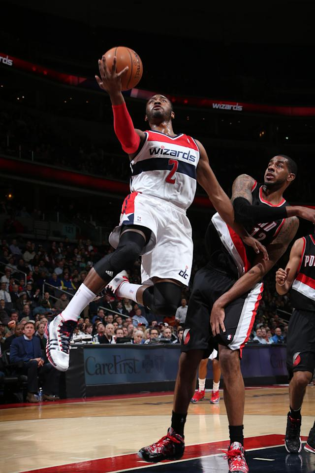 WASHINGTON, DC - FEBRUARY 3: John Wall #2 of the Washington Wizards shoots against LaMarcus Aldridge #12 of the Portland Trail Blazers during the game at the Verizon Center on February 3, 2014 in Washington, DC. (Photo by Ned Dishman/NBAE via Getty Images)