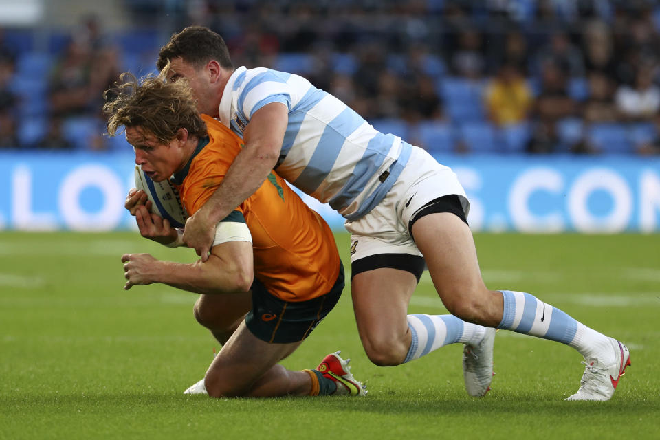Australia's Michael Hooper, left, is tackled by Argentina's Emiliano Boffelli during their Rugby Championship test match on the Gold Coast, Australia, Saturday, Oct. 2, 2021. (AP Photo/Tertius Pickard)