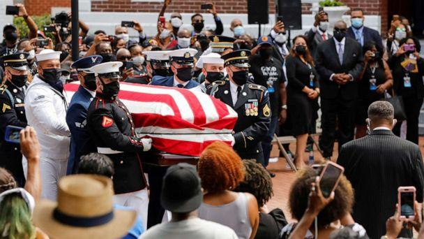 PHOTO: The casket of late congressman John Lewis, who died July 17, is carried outside the Brown Chapel A.M.E. Church in Selma, Alabama, July 26, 2020. (Christopher Aluka Berry/Reuters)