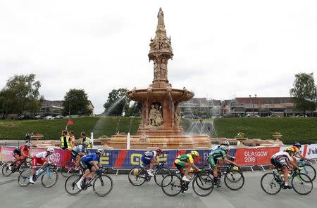 2018 European Championships - Road Cycling, Road Race Women - Glasgow, Britain - August 5, 2018 - Cyclists ride past Doulton Fountain in Glasgow Green. REUTERS/Peter Cziborra