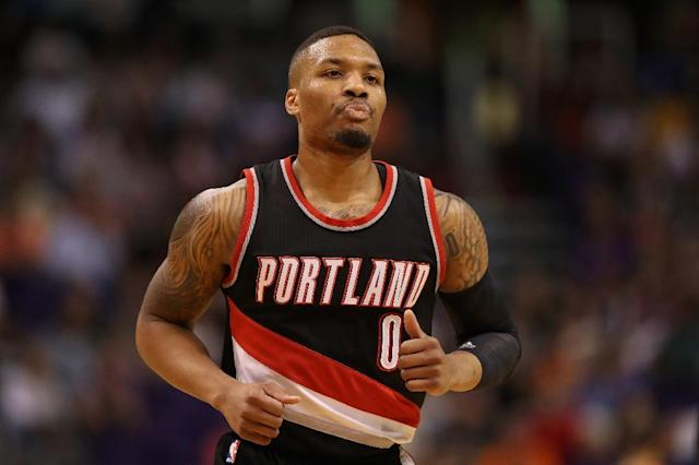 Damian Lillard scored a franchise-record 59 points to power the Portland Trail Blazers to a 101-86 victory over the Utah Jazz, at Moda Center in Portland, Oregon, on April 8, 2017 (AFP Photo/Christian Petersen)