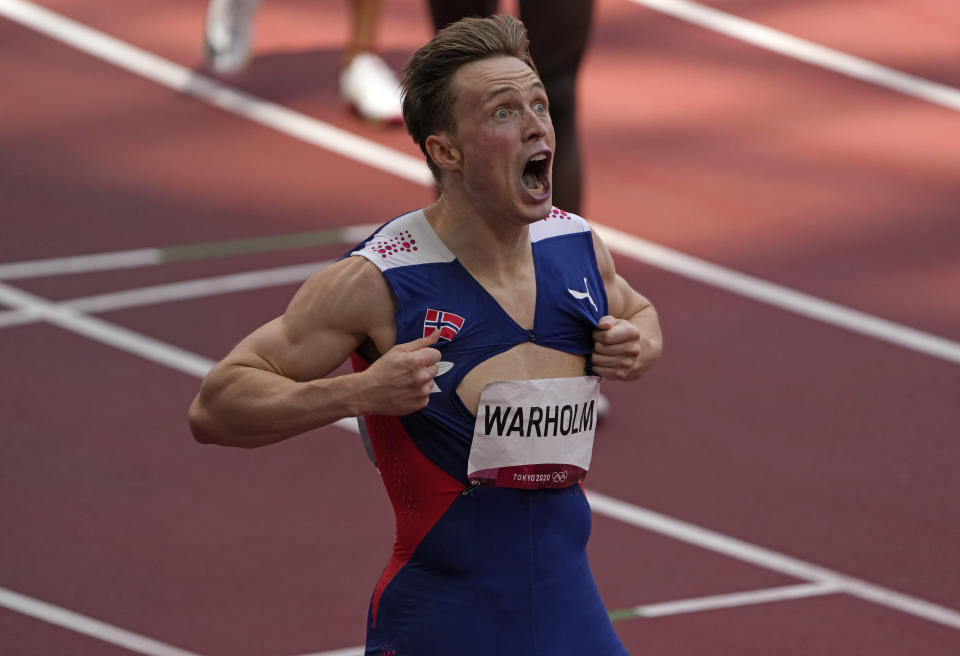 Karsten Warholm, of Norway celebrates as he wins the gold medal in the final of the men's 400-meter hurdles at the 2020 Summer Olympics, Tuesday, Aug. 3, 2021, in Tokyo, Japan. (AP Photo/Charlie Riedel)