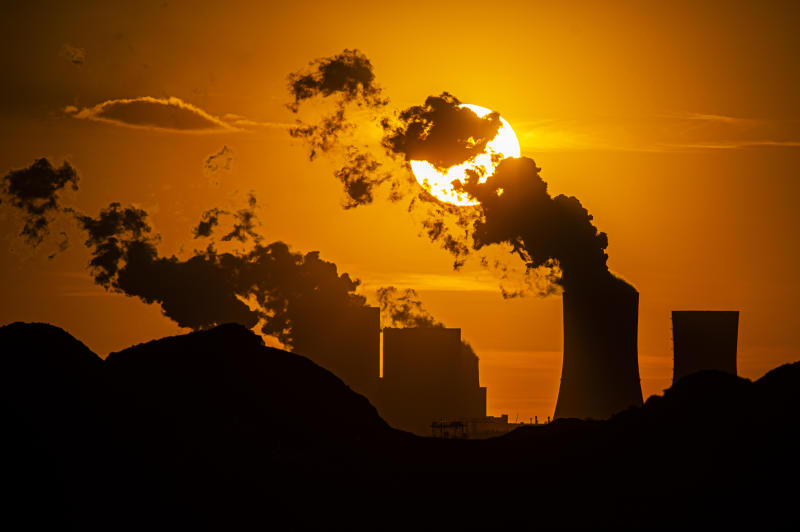 HAMMERSTADT, GERMANY - APRIL 09: The coal-fired power station Boxberg and the open-face mine Reichwalde are pictured in front of the setting sun on April 09, 2020 in Hammerstadt, Germany. The Boxberg power plant is going to be powered off in 2038 as part of the german coal phase-out. The region Lusatia in the east of Germany and its economic infrastructure is heavily dependent on the coal-fired power plants in Jaenschwalde, Schwarze Pumpe and Boxberg. (Photo by Florian Gaertner/Photothek via Getty Images)