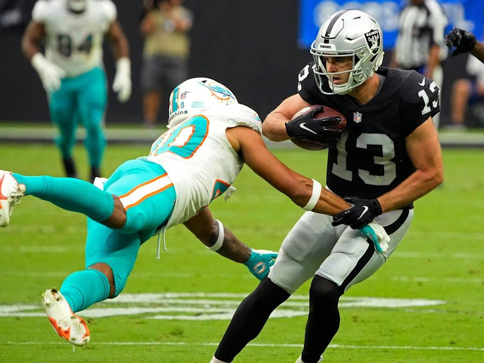 Hunter Renfrow breaks a tackle against the Miami Dolphins.