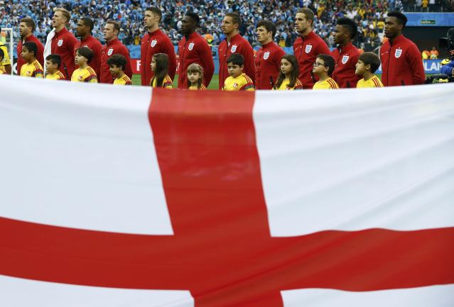 England's national soccer players pose for a group photo ahead of their 2014 World Cup Group D soccer match against Uruguay at the Corinthians arena in Sao Paulo June 19, 2014. REUTERS/Damir Sagolj (BRAZIL - Tags: SOCCER SPORT WORLD CUP TPX IMAGES OF THE DAY)