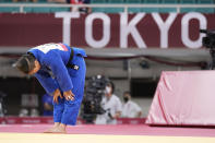 Funa Tonaki of Japan reacts after competing against Distria Krasniqi of Kosovo during their women's -48kg championship judo match at the 2020 Summer Olympics, Saturday, July 24, 2021, in Tokyo, Japan. (AP Photo/Vincent Thian)