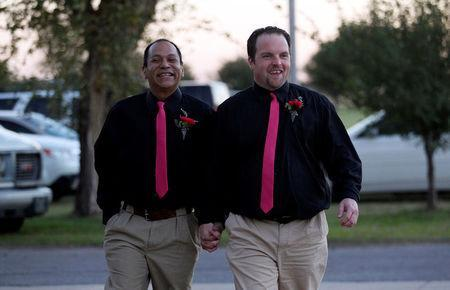 FILE PHOTO: Darren Black Bear (L) and Jason Pickel arrive to be married by Darren's father Rev. Floyd Black Bear in El Reno, Oklahoma October 31, 2013. REUTERS/Rick Wilking/File Photo