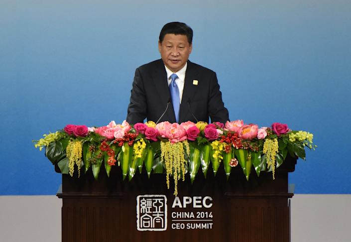 China's President Xi Jinping met Hong Kong chief executive in Beijing as the city hosts the APEC summit. A delayed trading link will open on November 17 (AFP Photo/Wang Zhao)