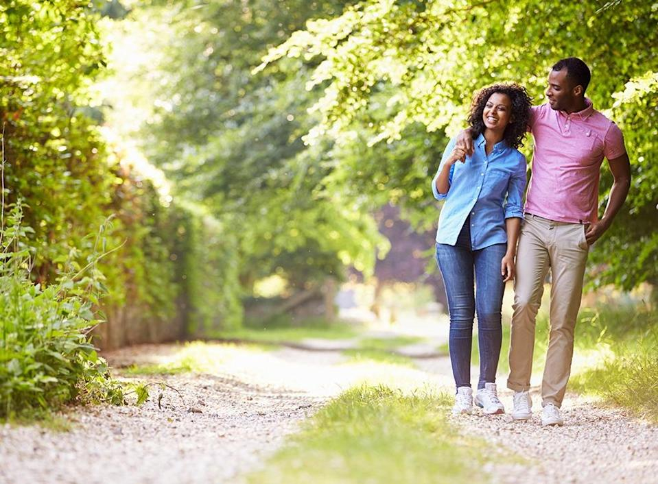 """Think hitting the pavement isn't worth it if you aren't all-out running? Think again. Walking might protect against <a href=""""https://bestlifeonline.com/heart-disease-risk-factors/?utm_source=yahoo-news&utm_medium=feed&utm_campaign=yahoo-feed"""" rel=""""nofollow noopener"""" target=""""_blank"""" data-ylk=""""slk:heart disease"""" class=""""link rapid-noclick-resp"""">heart disease</a> even better than running does, according to a 2013 study in <em>Arteriosclerosis, Thrombosis and Vascular Biology.</em> When 33,000 runners and 15,000 walkers burned the same amount of energy, based on the distance they covered, the walking group <a href=""""https://www.sciencedaily.com/releases/2013/04/130404170225.htm"""" rel=""""nofollow noopener"""" target=""""_blank"""" data-ylk=""""slk:reduced their risk of coronary heart disease"""" class=""""link rapid-noclick-resp"""">reduced their risk of coronary heart disease</a> by 9.3 percent, compared to 4.5 percent for the runners. They also had better improvements in their risks of first-time high blood pressure and cholesterol, and a slightly lowered risk of developing diabetes."""