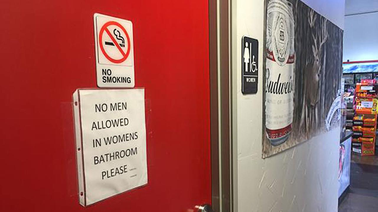 A sign on the women's bathroom door at the Texaco Station and BBQ on the Brazos restaurant seems to make clear the owner's stance on the transgender restroom issue.