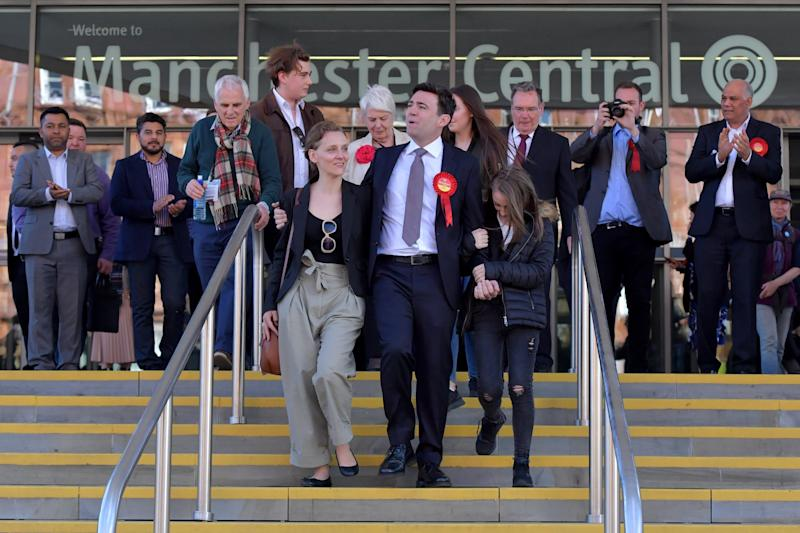 <strong>Labour's Andy Burnham (C) celebrates winning the Greater Manchester mayoral election with wife Marie-France van Heel (L) and daughter Annie (R) at Manchester Central</strong> (Anthony Devlin via Getty Images)