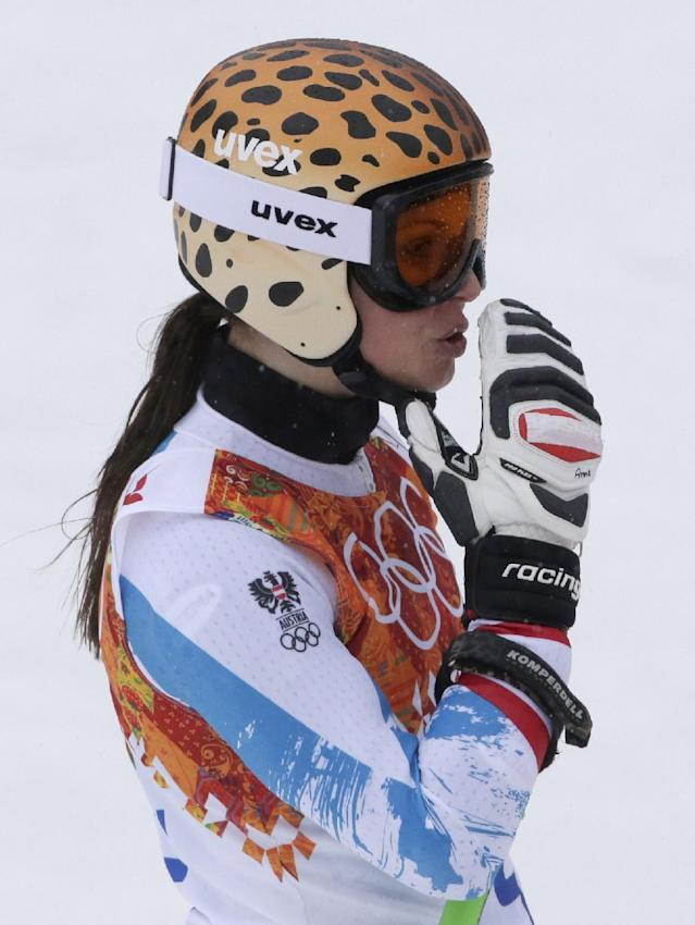 Austria's Anna Fenninger blows a kiss after finishing the second run of the women's giant slalom at the Sochi 2014 Winter Olympics, Tuesday, Feb. 18, 2014, in Krasnaya Polyana, Russia. (AP Photo/Gero Breloer)