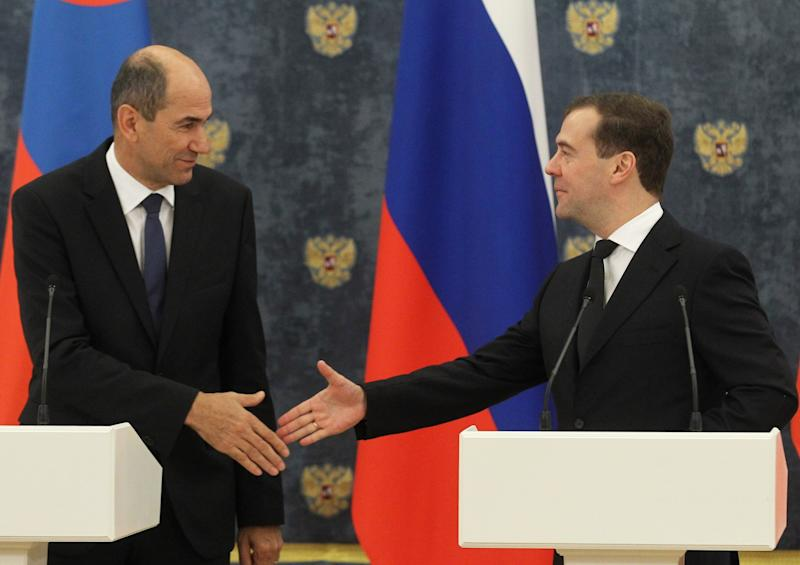 Russian Premier Dmitry Medvedev, right, shakes hands with visiting Slovenian counterpart Janez Jansa after signing documents on the South Stream pipeline construction at the Gorki residence outside Moscow on Tuesday, Nov. 13, 2012. The South Stream pipeline, due to start operating in 2015, would ship up to 63 billion cubic meters of gas annually from Russia under the Black Sea to Bulgaria, Serbia, Hungary, Slovenia, Austria and Italy in one leg, and Croatia and Greece in a second. (AP Photo/RIA Novosti, Yekaterina Shtukina, Government Press service)
