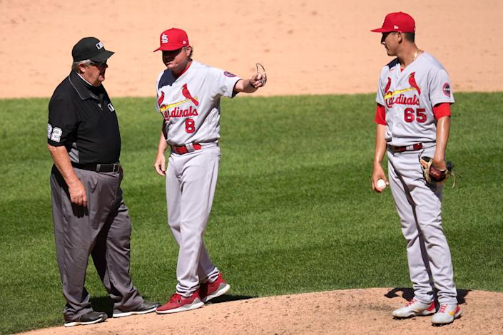 Cardinals manager Mike Shildt argues with umpires after they ordered Giovanny Gallegos to switch caps because there was sunscreen on the bill during a game in May.
