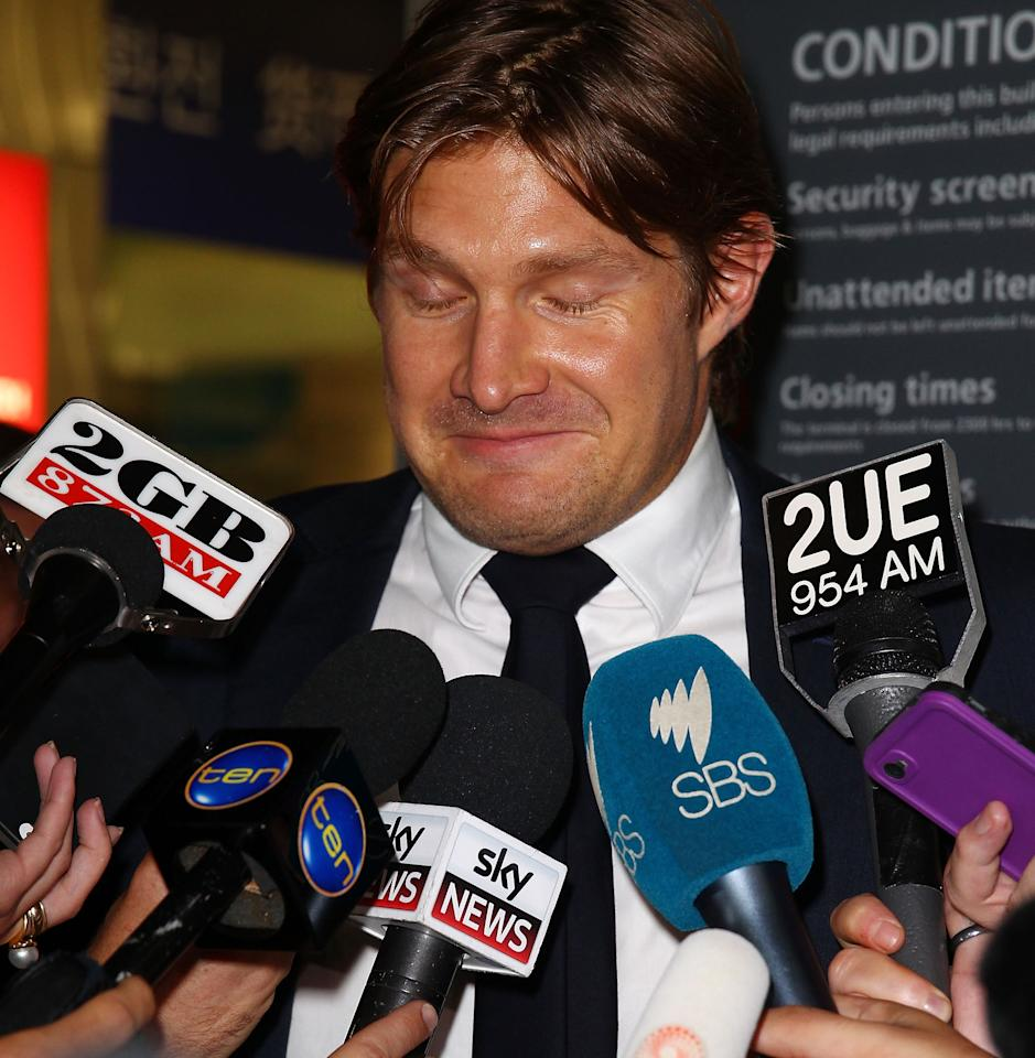 SYDNEY, AUSTRALIA - MARCH 12:  Shane Watson stops to answer questions from the media upon arrival at Sydney International Airport on March 12, 2013 in Sydney, Australia. Watson returned home after disciplinary action in place with the Australia test cricket team  (Photo by Don Arnold/Getty Images)