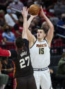 Denver Nuggets center Nikola Jokic shoots over Portland Trail Blazers center Jusuf Nurkic during the first half of Game 6 of an NBA basketball first-round playoff series Thursday, June 3, 2021, in Portland, Ore. (AP Photo/Craig Mitchelldyer)