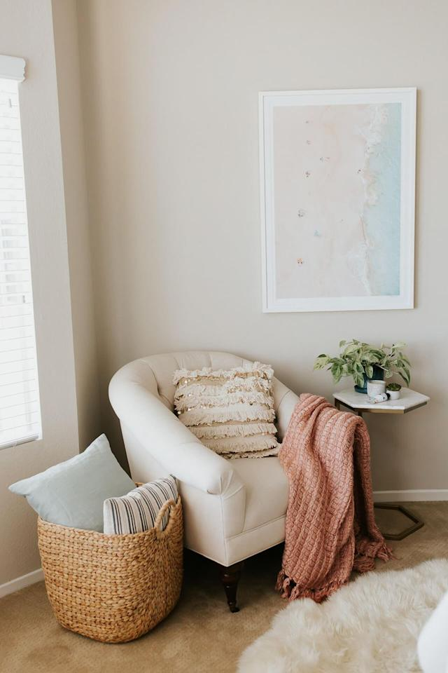 "<p>Between the oh-so-soft knit blanket, fringed throw pillow, woven basket, sheepskin rug, and marble-top side table, this reading corner from <a href=""https://mlovesm.com/2018/05/reading-nook/"">M Loves M</a> uses stylish textures to give the space an elevated feel (in an easy-to-create way). The finishing touches: Beachy wall art by Gray Malin and a leafy plant add subtle, serene pops of color.</p>"
