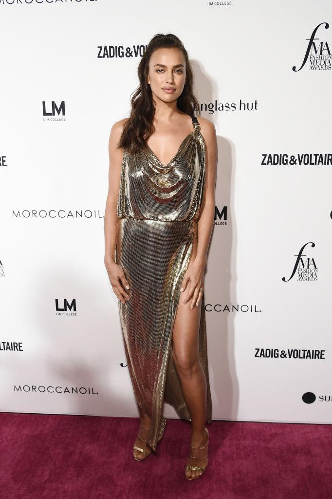 <p>Irina Shayk proved her sartorial prowess in a slinky thigh-split dress hot from the Versace runway finished with metallic shoes. <em>[Photo: Getty]</em> </p>