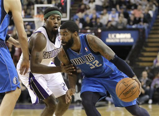 Dallas Mavericks guard O.J. Mayo, right, drives against Sacramento Kings forward John Salmons during the first quarter of an NBA basketball game in Sacramento, Calif., Friday, April 5, 2013. (AP Photo/Rich Pedroncelli)