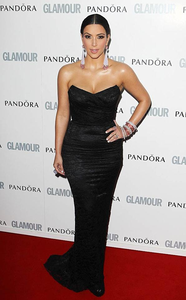 """Also in attendance was newly engaged reality TV titan Kim Kardashian, who channeled her inner Old Hollywood diva in a curve-hugging corset dress and statement earrings. Fred Duval/<a href=""""http://www.filmmagic.com/"""" target=""""new"""">FilmMagic.com</a> - June 7, 2011"""
