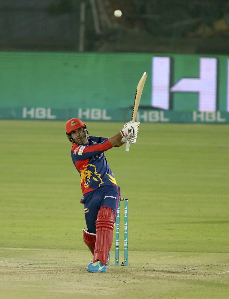 Karachi Kings Mohammad Nabi plays a shot for six during a Pakistan Super League T20 cricket match between Karachi Kings and Quetta Gladiators at National Stadium, in Karachi, Pakistan, Saturday, Feb. 20 2021. (AP Photo/Fareed Khan)