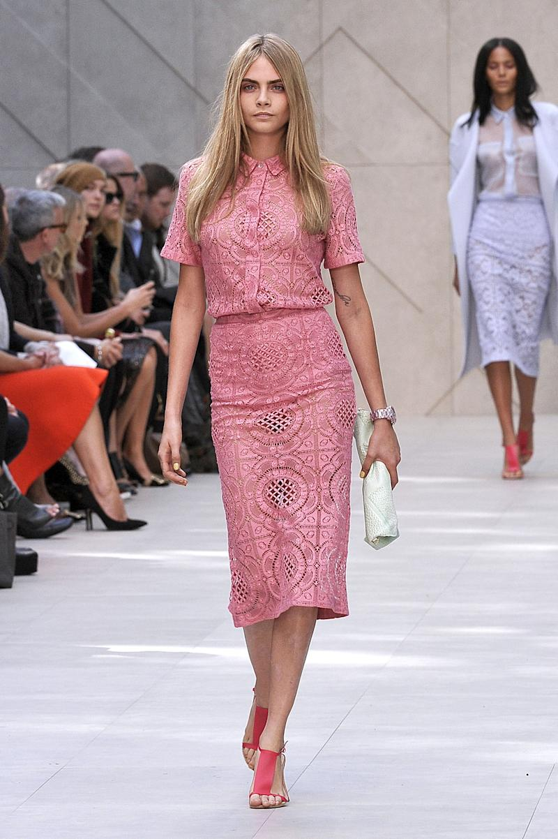 1c57faed082 View photos. Cara Delevingne walks the runway at the Burberry Prorsum show  at London Fashion Week spring/summer 2014 at Kensington Gardens on ...