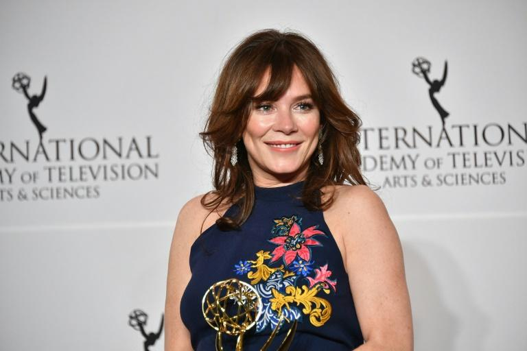 "Anna Friel poses with award for best performance by an actress for her work in ""Marcella"" at the 45th International Emmy Awards"