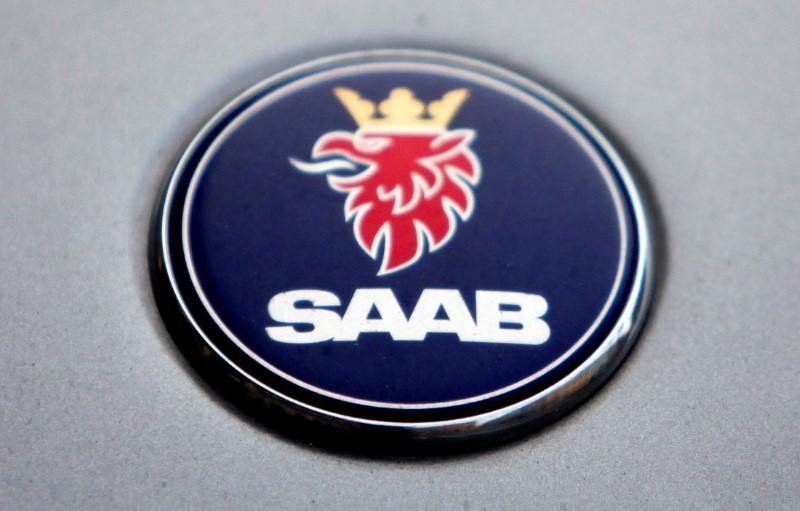 The logo of Swedish manufacturer Saab is seen on a car in Prague