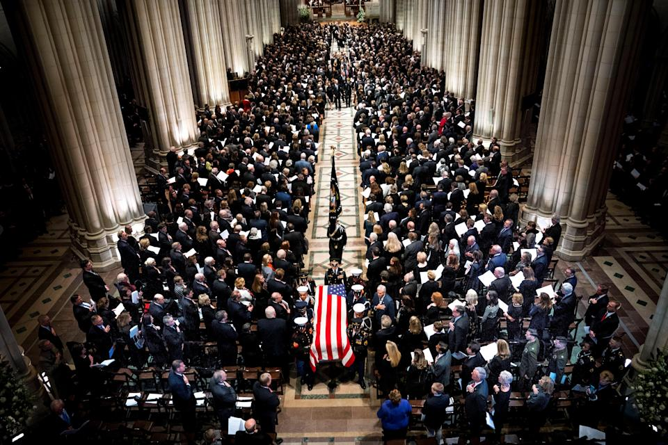 The Honor Guard carries the casket of former president George Herbert Walker Bush down the center isle following a memorial ceremony at the National Cathedral in Washington, Wednesday, Dec. 5, 2018. (Photo: Doug Mills/Pool via Reuters)
