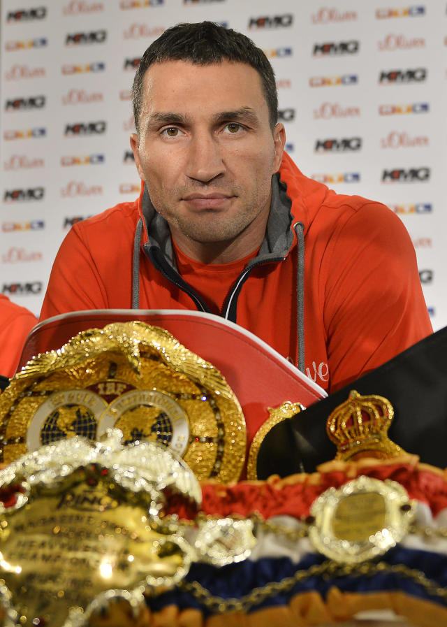 Boxing champion Wladimir Klitschko of Ukraine sits behind his belts as he attends a press conference ahead of his IBF, IBO, WBO and WBA heavyweight title bout against challenger Alex Leapai from Australia-Samoa in Duesseldorf, Germany, Tuesday, April 22, 2014. (AP Photo/Martin Meissner)